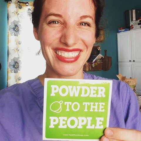 """woman holding up a sign that says """"power to the people"""""""