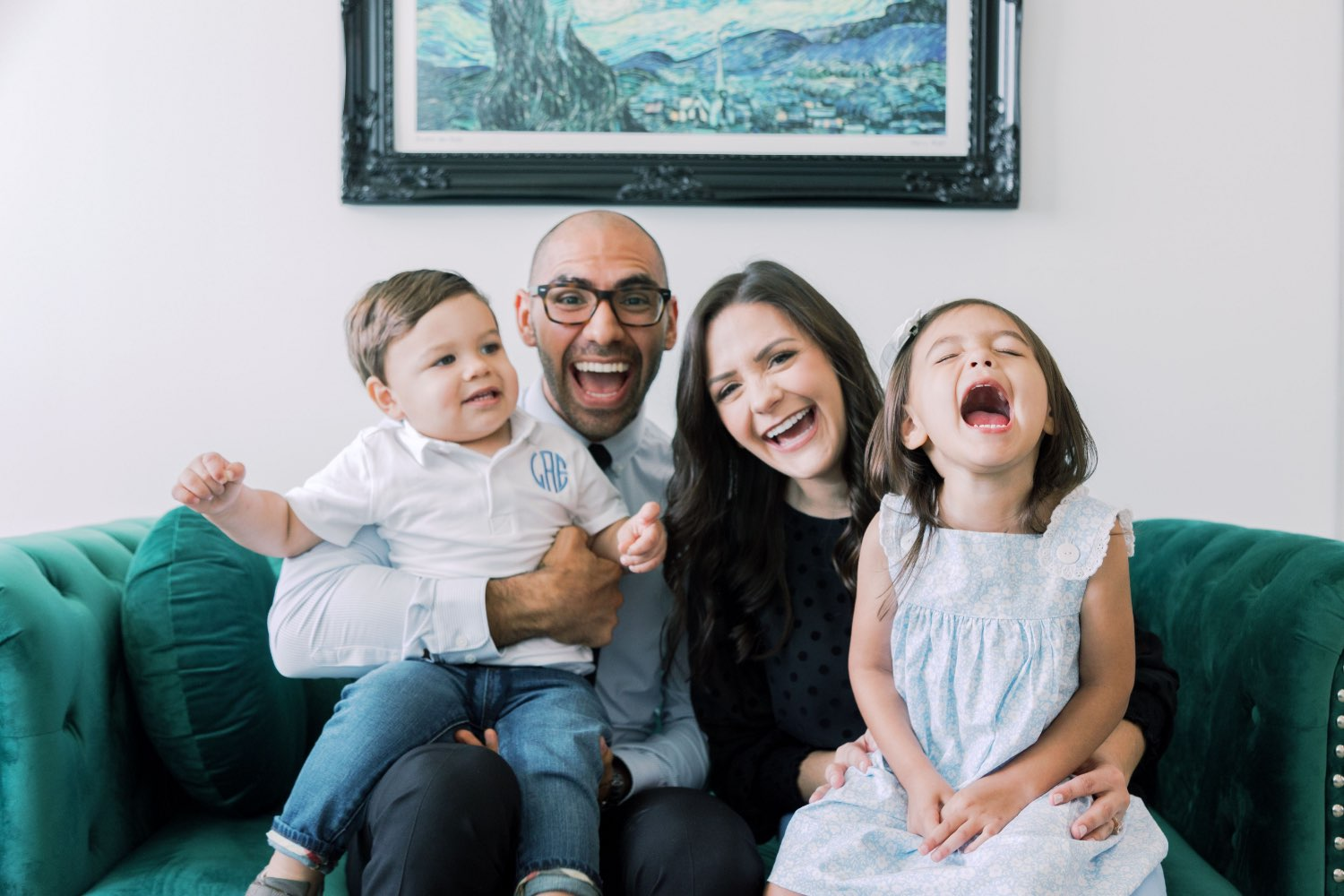 Photo of New Braunfels dentists Dr. Forrest Arguelles & Dr. Courtney Arguelles with their two children