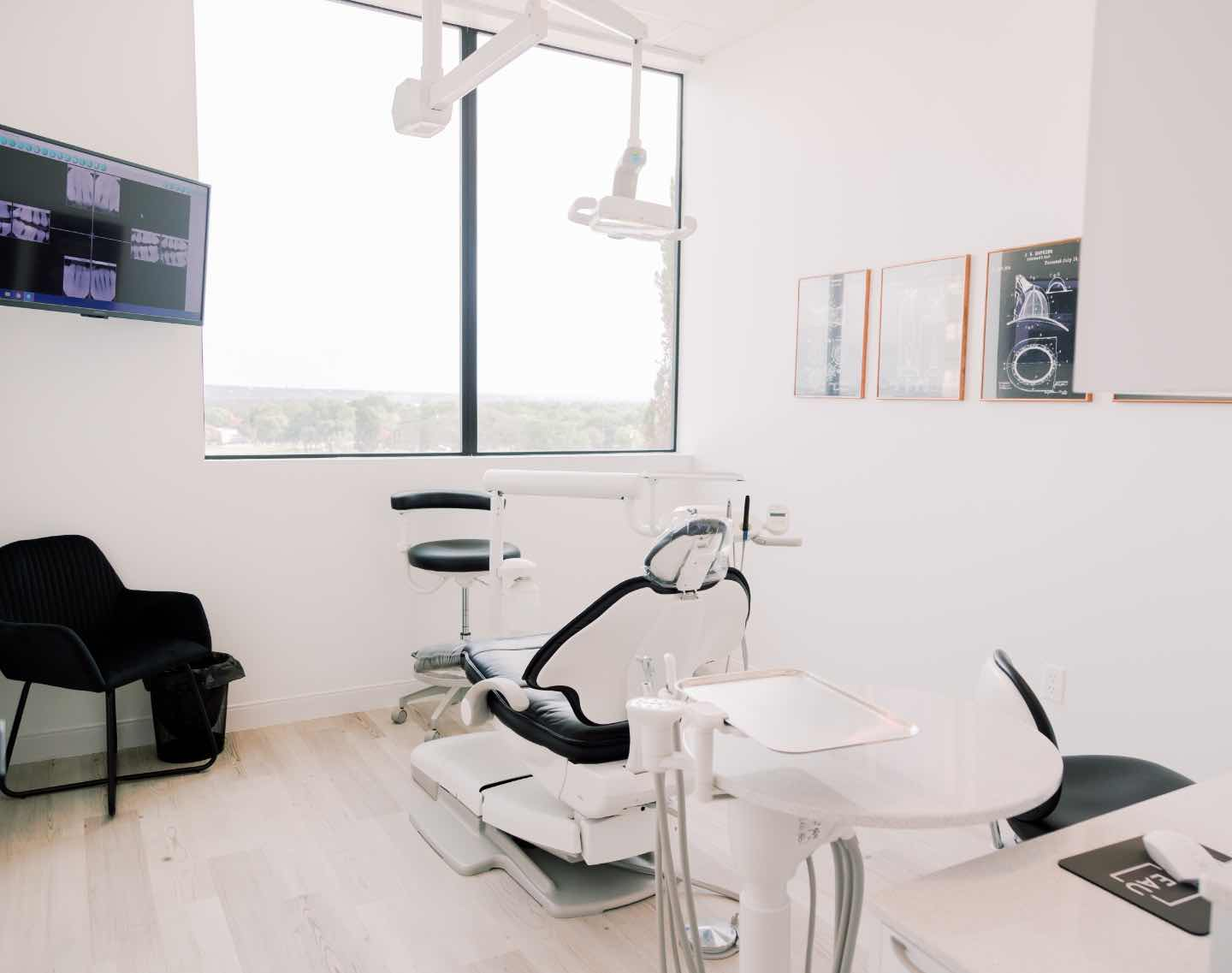 Photo of a dental chair in a bright, clean treatment room