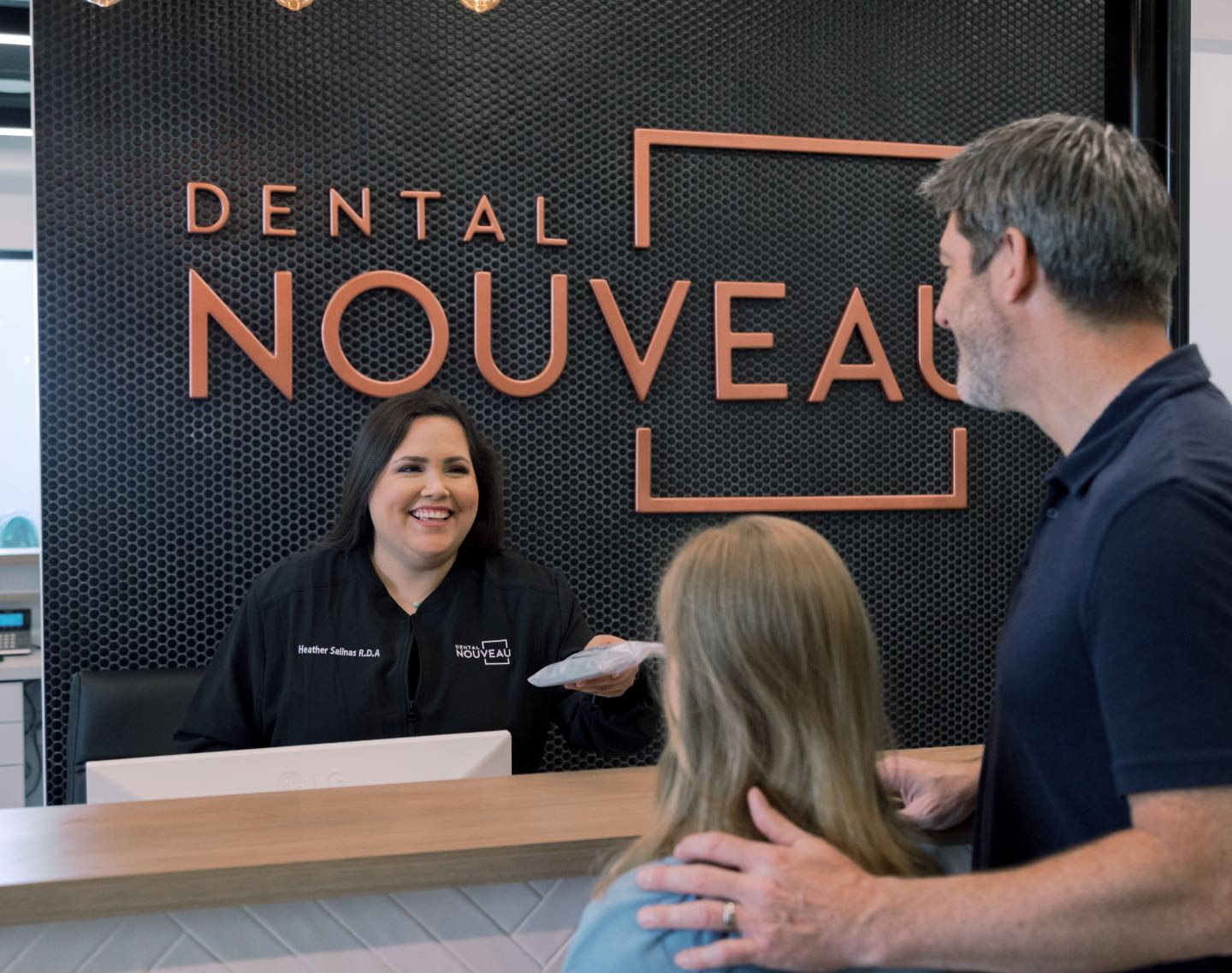 Photo of the receptionist at the Dental Nouveau front desk