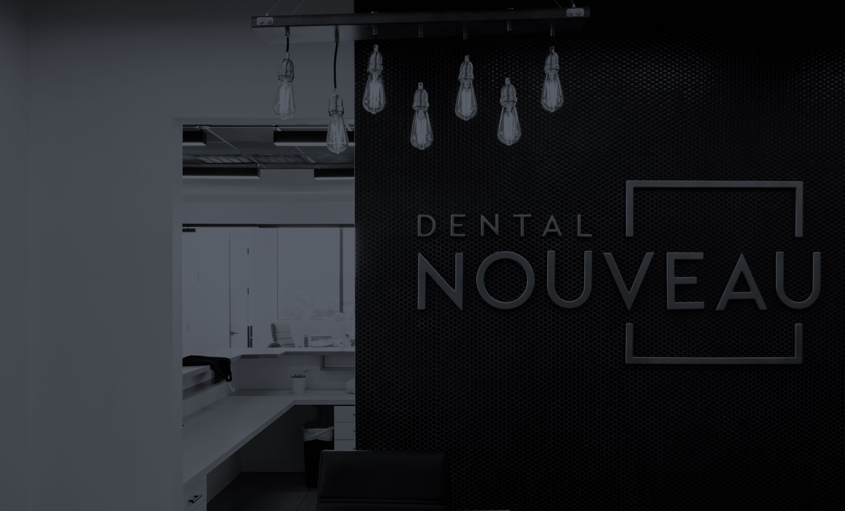 Photo of a wall in our practice with a Dental Nouveau sign