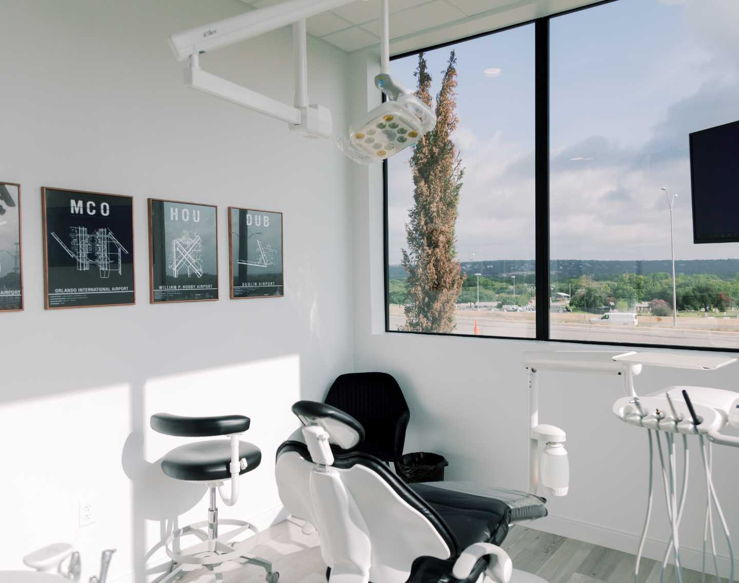 Photo of a bright, clean, and open dental exam room