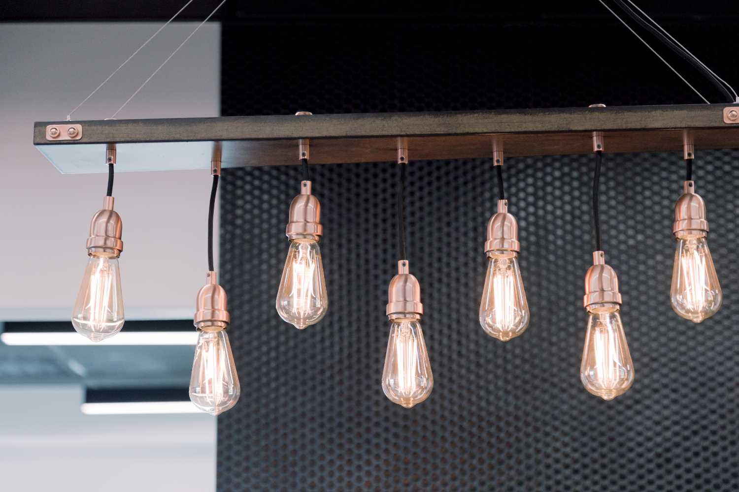 Photo of Edison light bulbs hanging down in our office