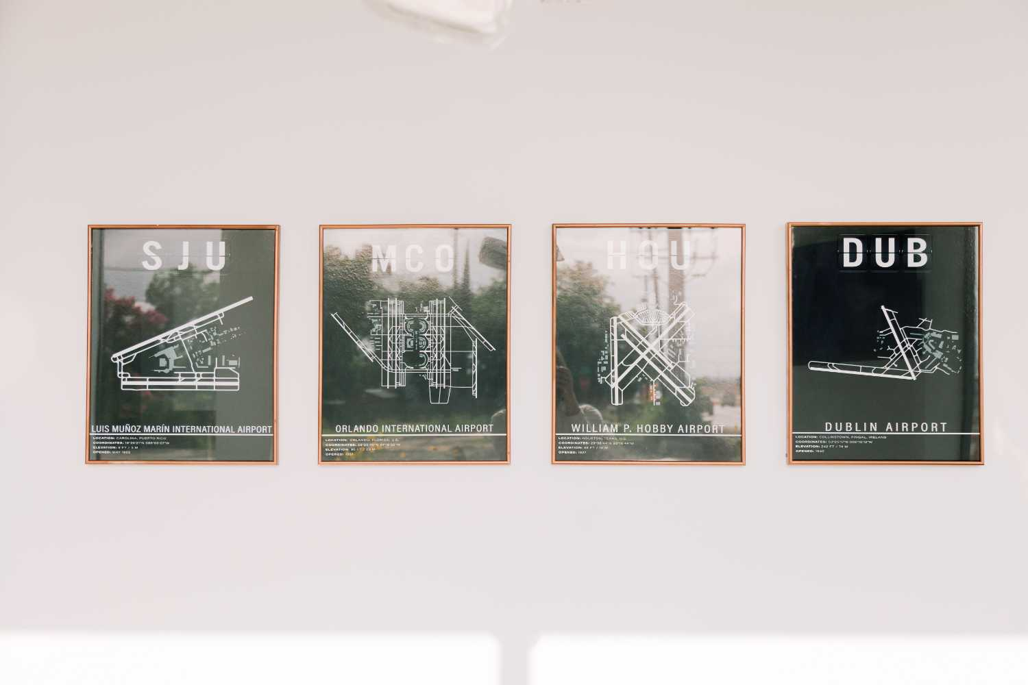 Photos of the wall art at our office, featuring airport diagrams