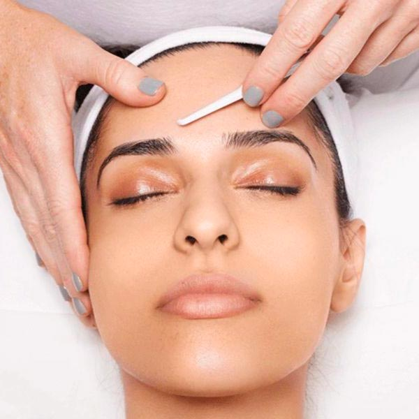 Dermaplaning of a woman's face in Chandler.