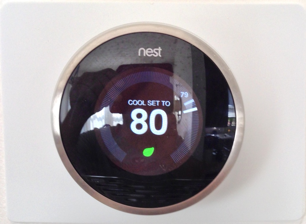 NEST LEARNING THERMOSTAT WITH ENERGY SAVINGS SETTING ICON
