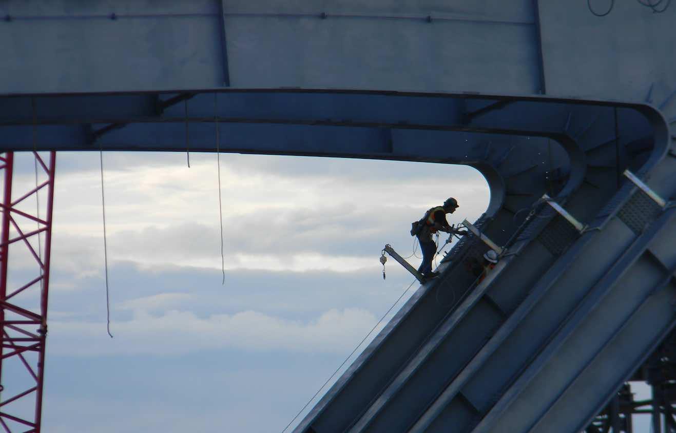 ironworker working on a bridge