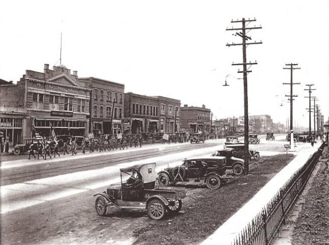 A street with antiquated cars from the past