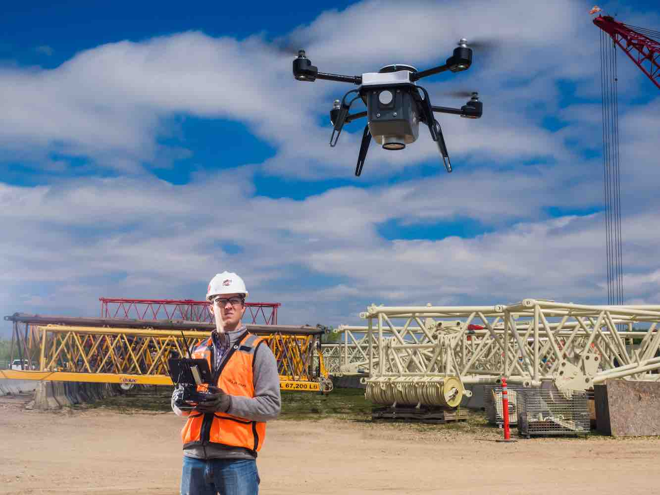 drone pilot flying a drone on a construction site