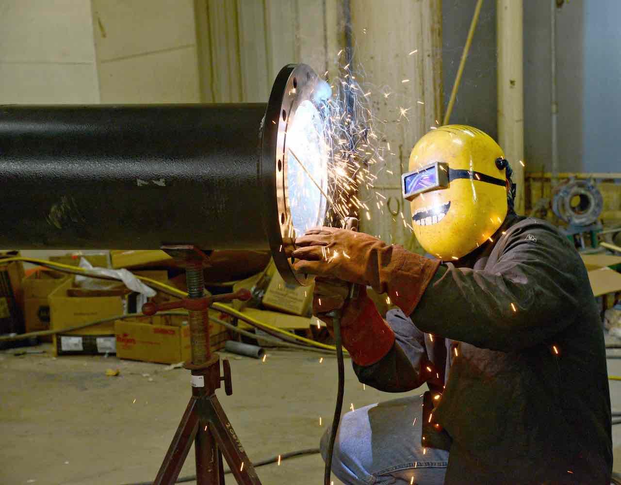 a welder welding a large pipe