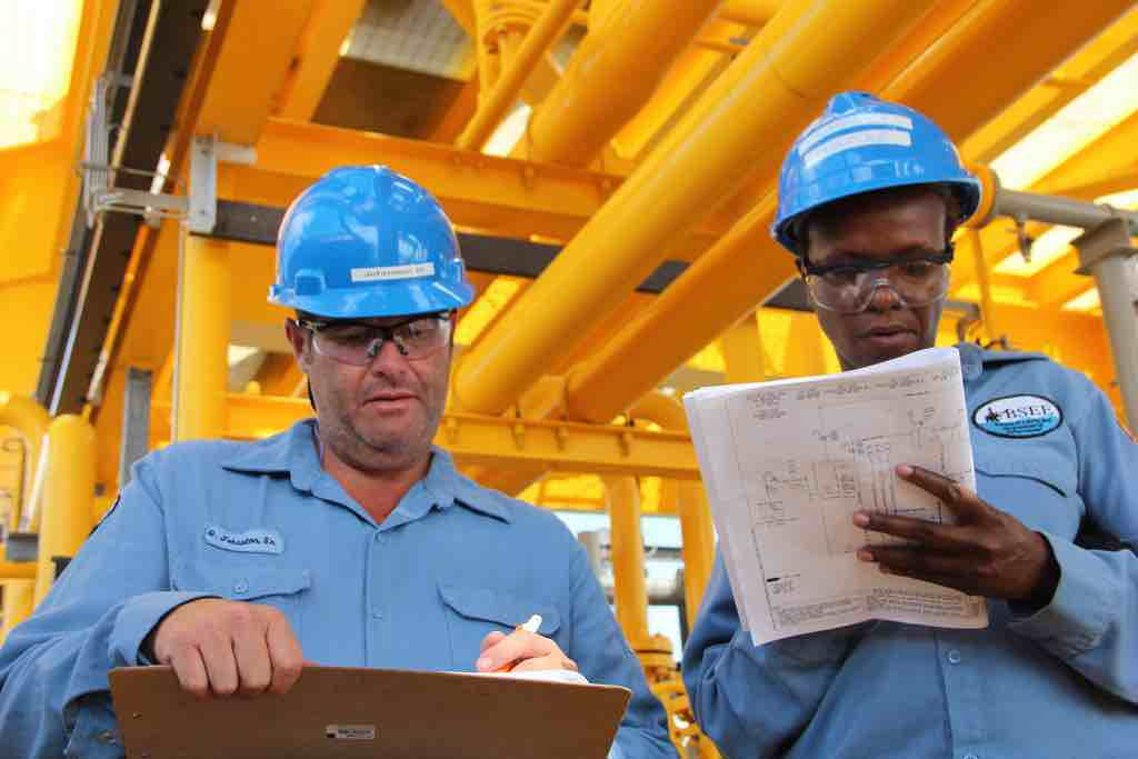 two construction inspectors performing manual inspection