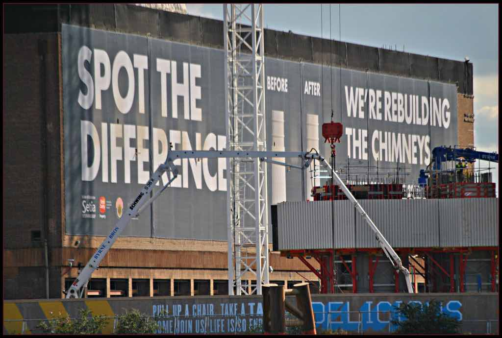 Construction company billboard ad on construction site