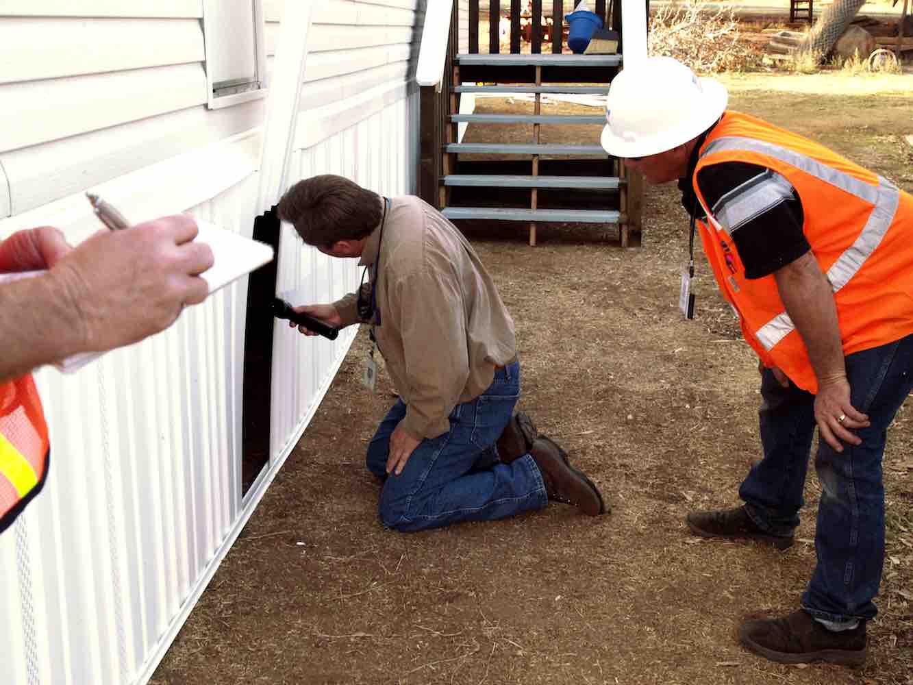 construction inspectors inspecting a home for FEMA