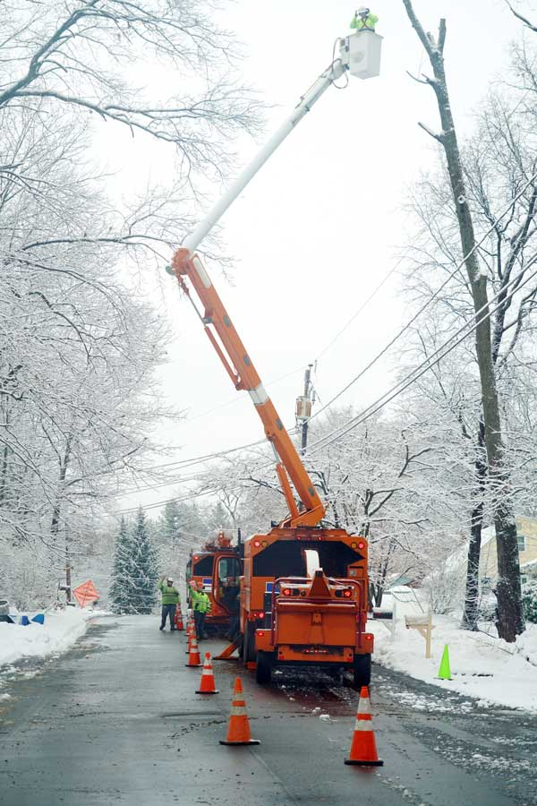 A utility crew repairing a power line after a winter storm