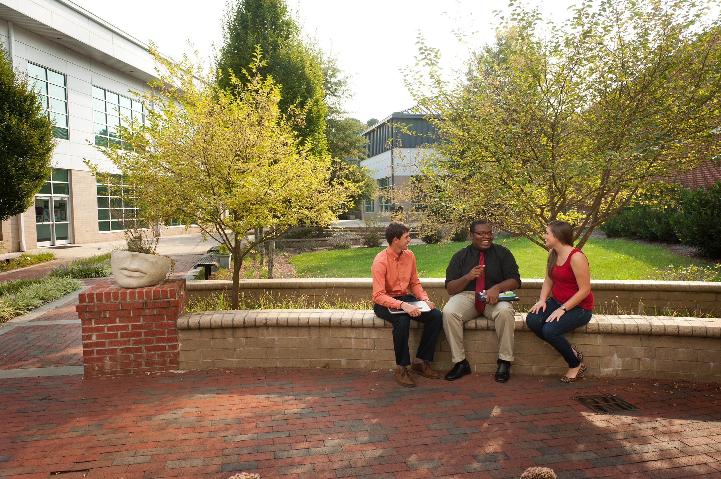 3 members of the campus community enjoy each others' company. Informal social spaces are key to fostering a vibrant campus!