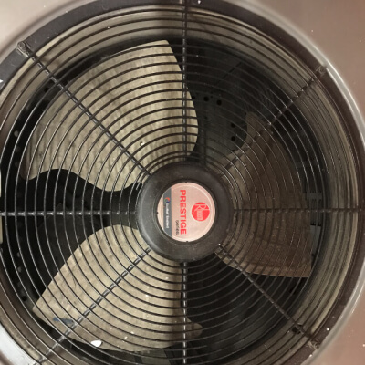 Fan of an AC unit blowing cold air conditioning air