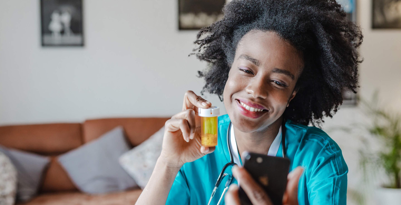 A nurse providing directions about a medication via a telemedicine conference