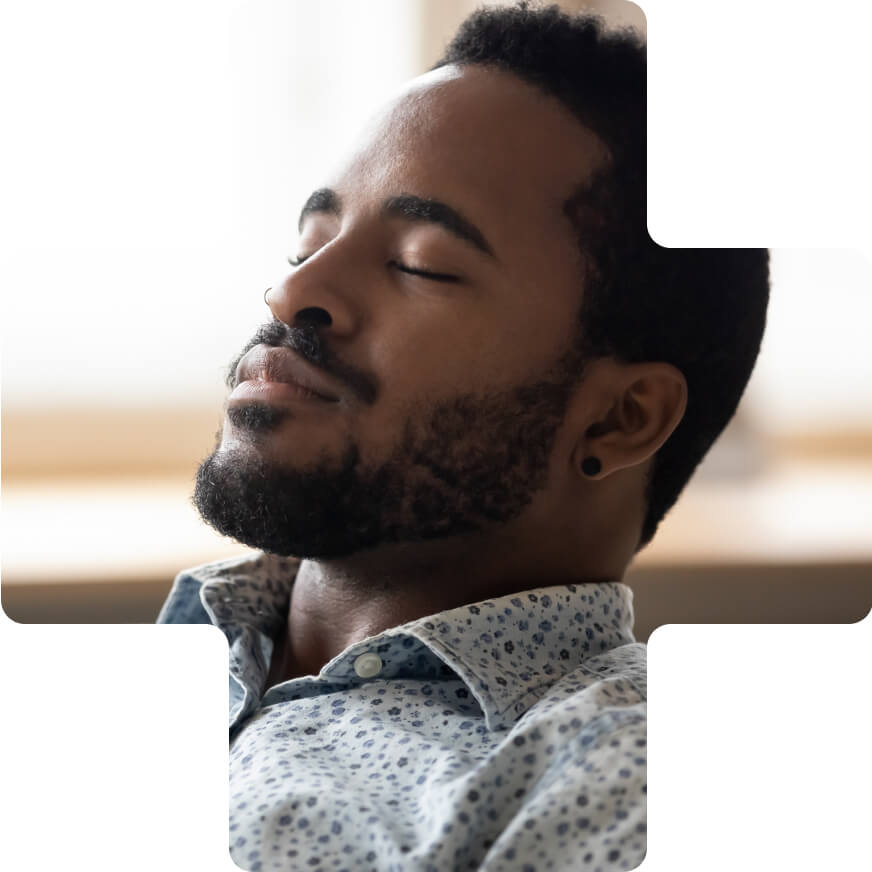 A man relaxing and meditating