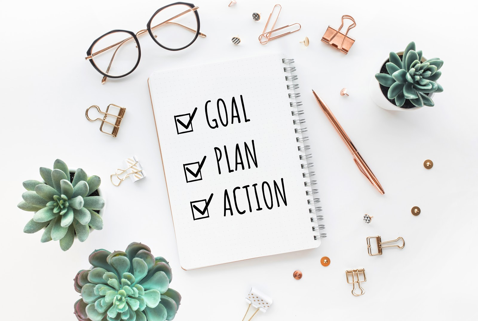"""How to raise money: Notebook that says """"goal, plan, action"""""""