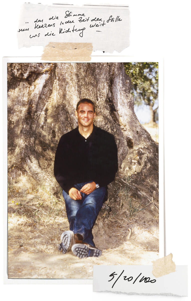 Photo of Thomas Lommel sitting at an Olive Tree