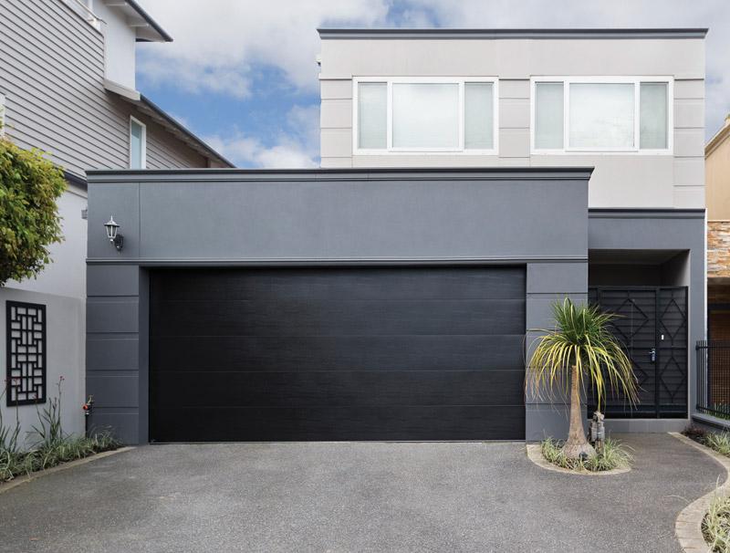 Custom garage door matte black panel lift