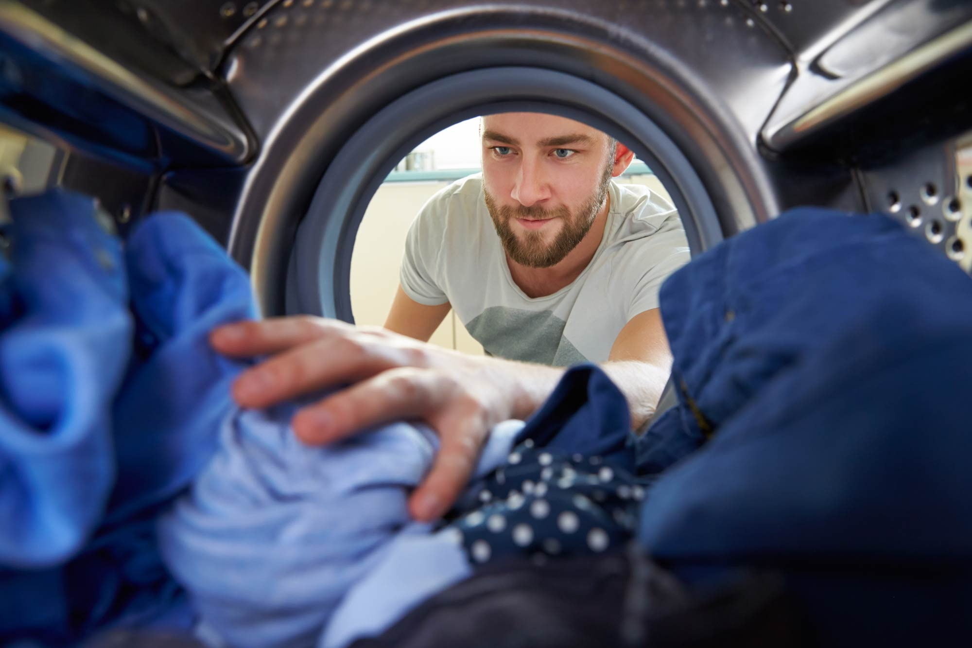 Person grabbing clothes from dryer