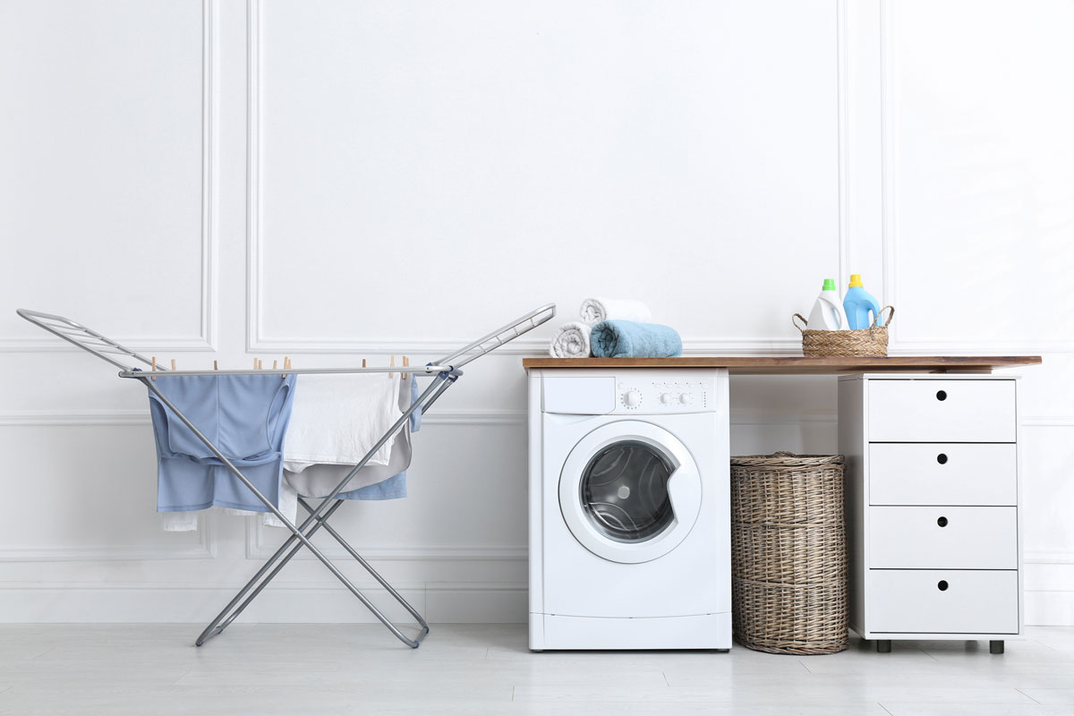 Dryer with clothes hanging to dry