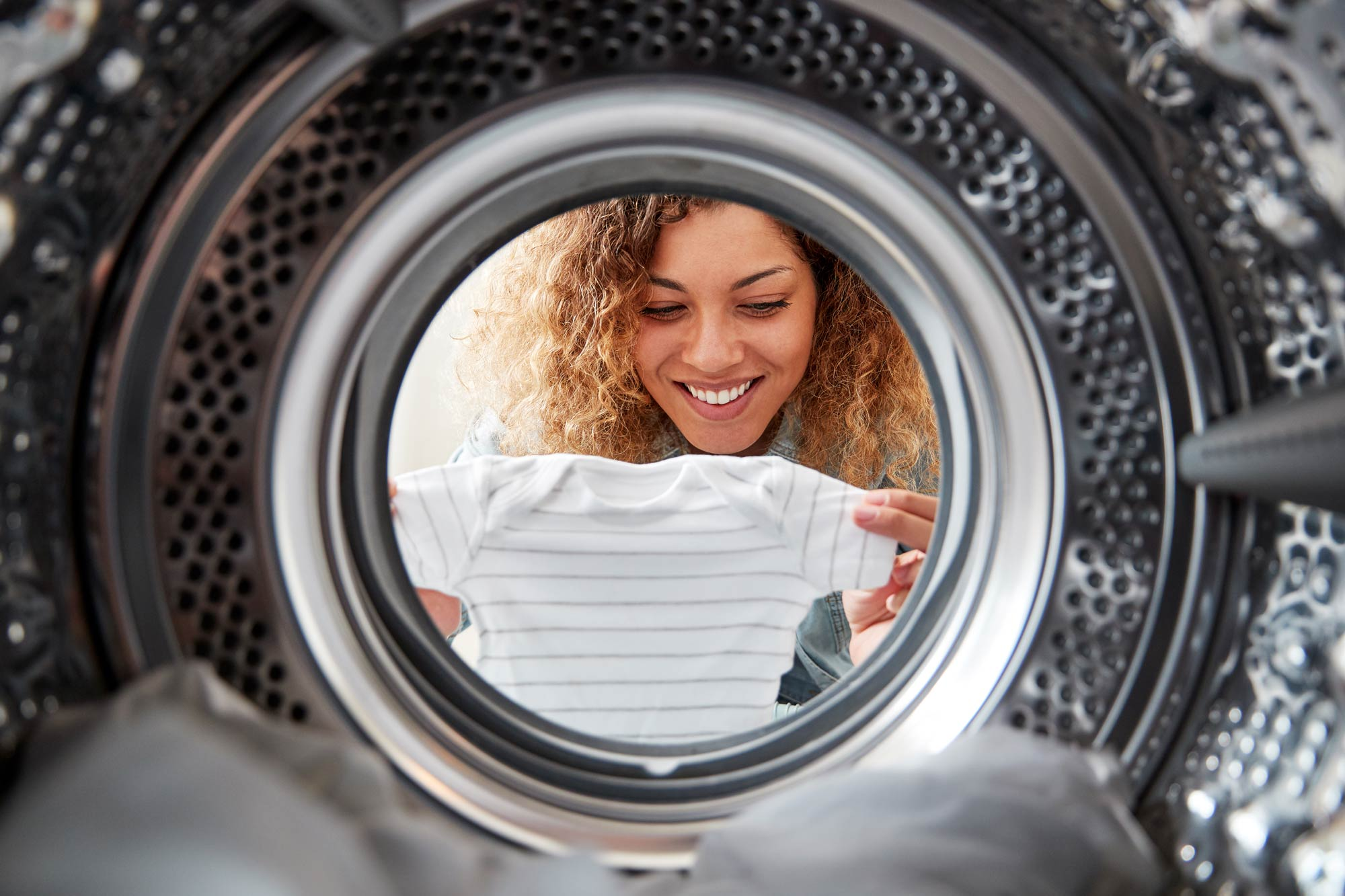 Person using clothes dryer