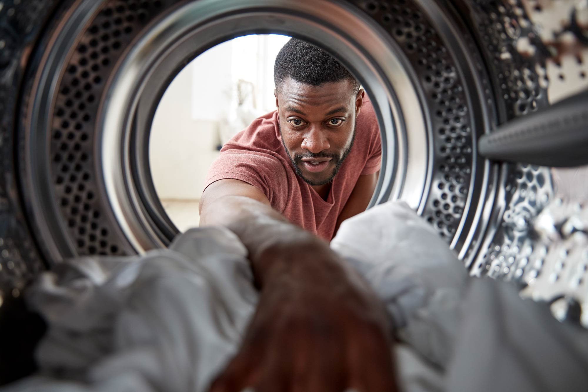 Person removing clothes from dryer