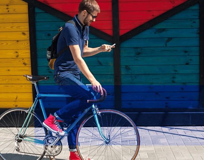 A guy using bi-cycle