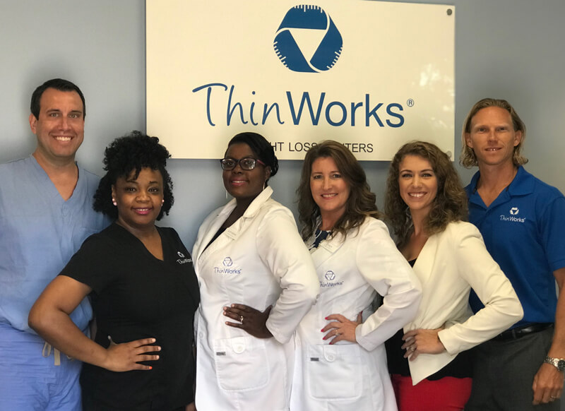 The entire Thin Works team standing together.
