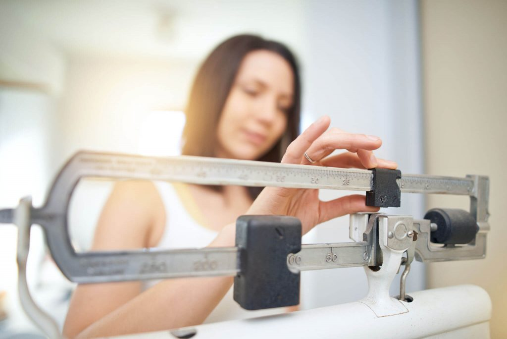 Weight Loss 33458 woman measuring weight