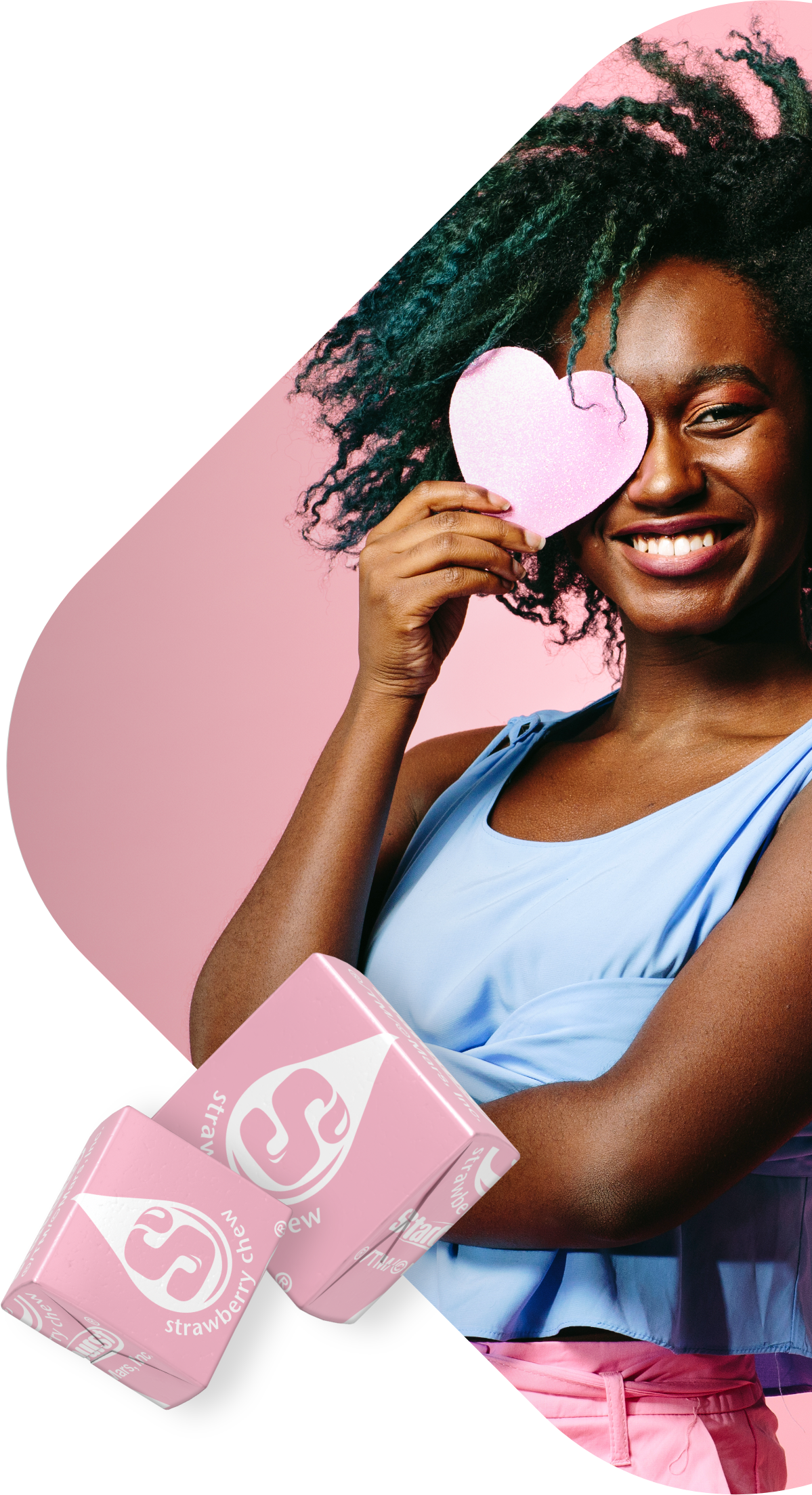 An image of a woman smiling while holding a heart shape over her eye