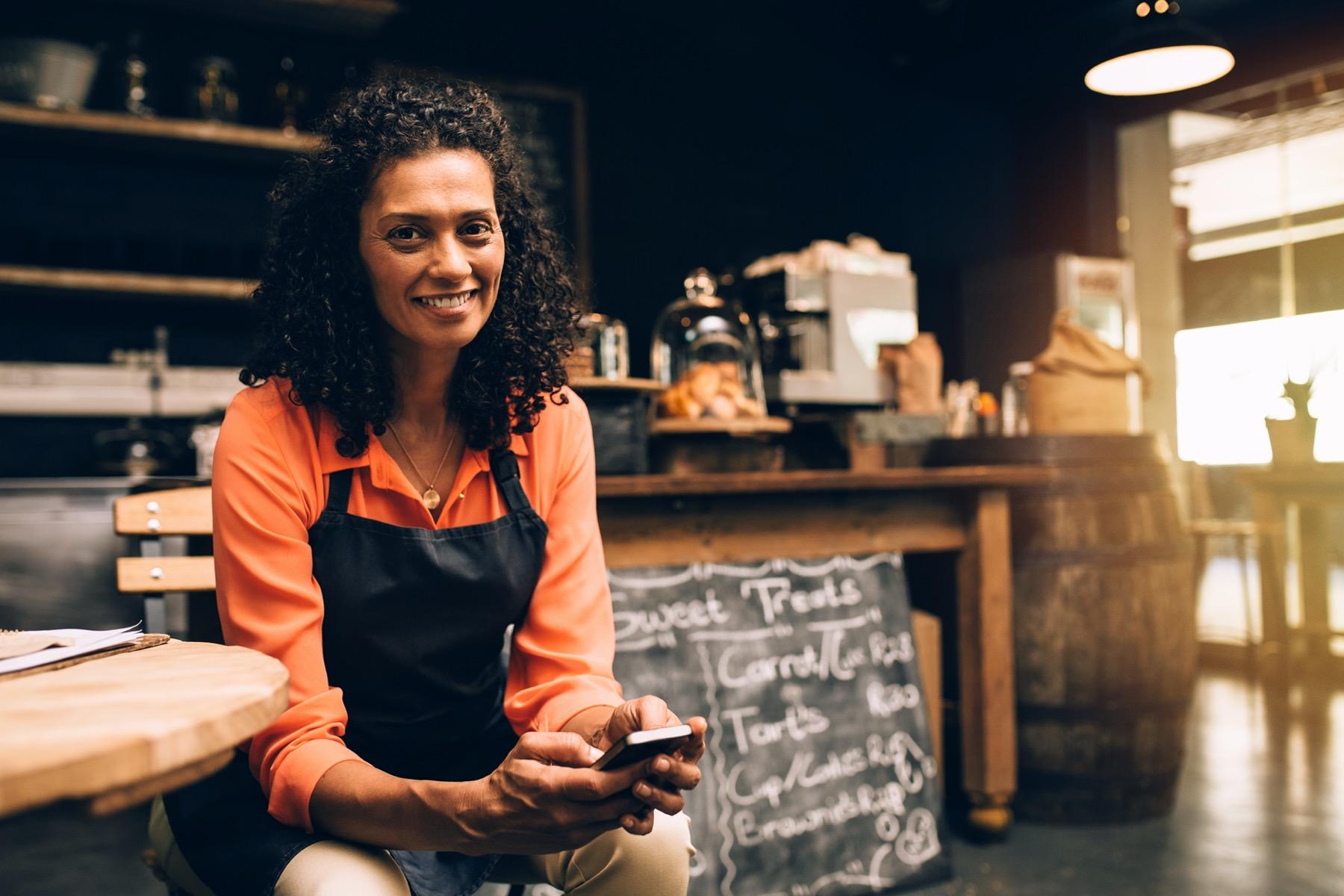 Restaurant employee doing workforce training on mobile phone