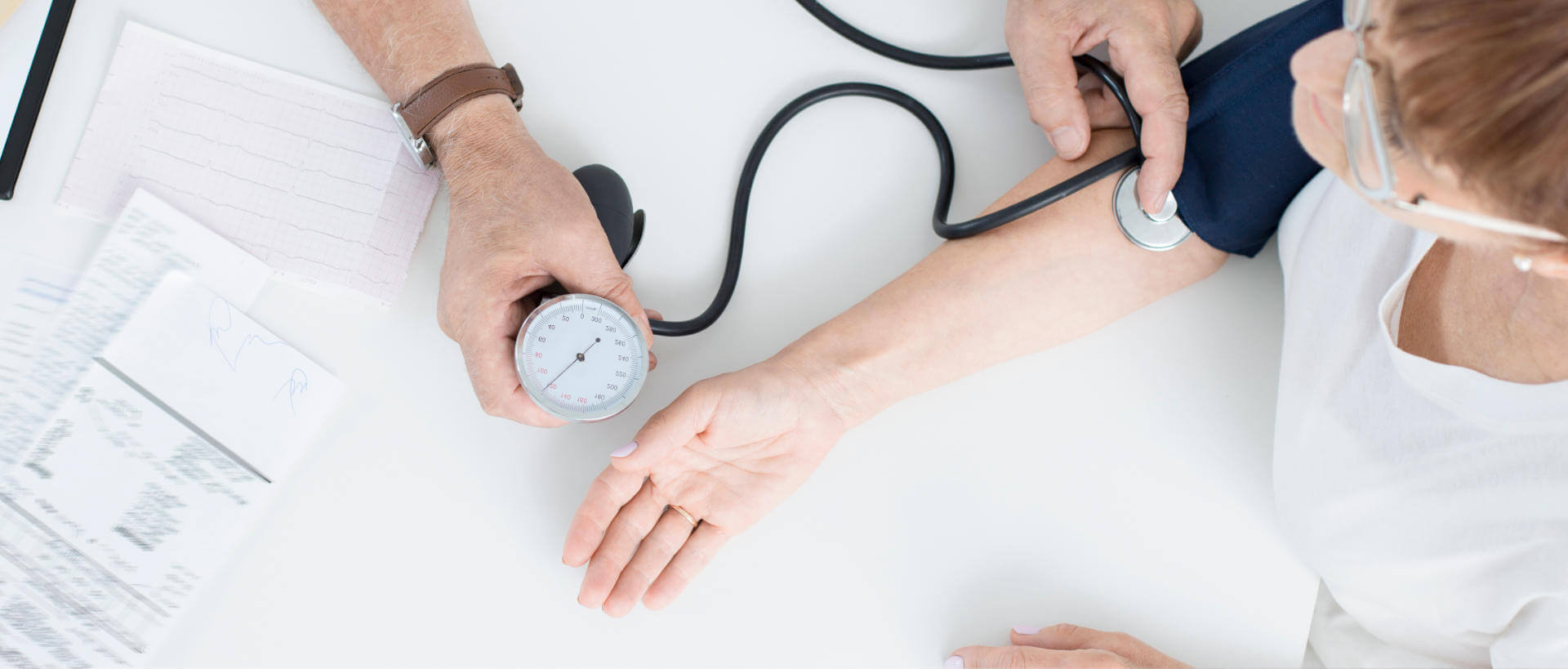 Patient having blood pressure taken by physician