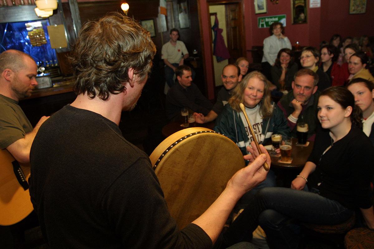 Man playing traditional Irish instrument bodhran