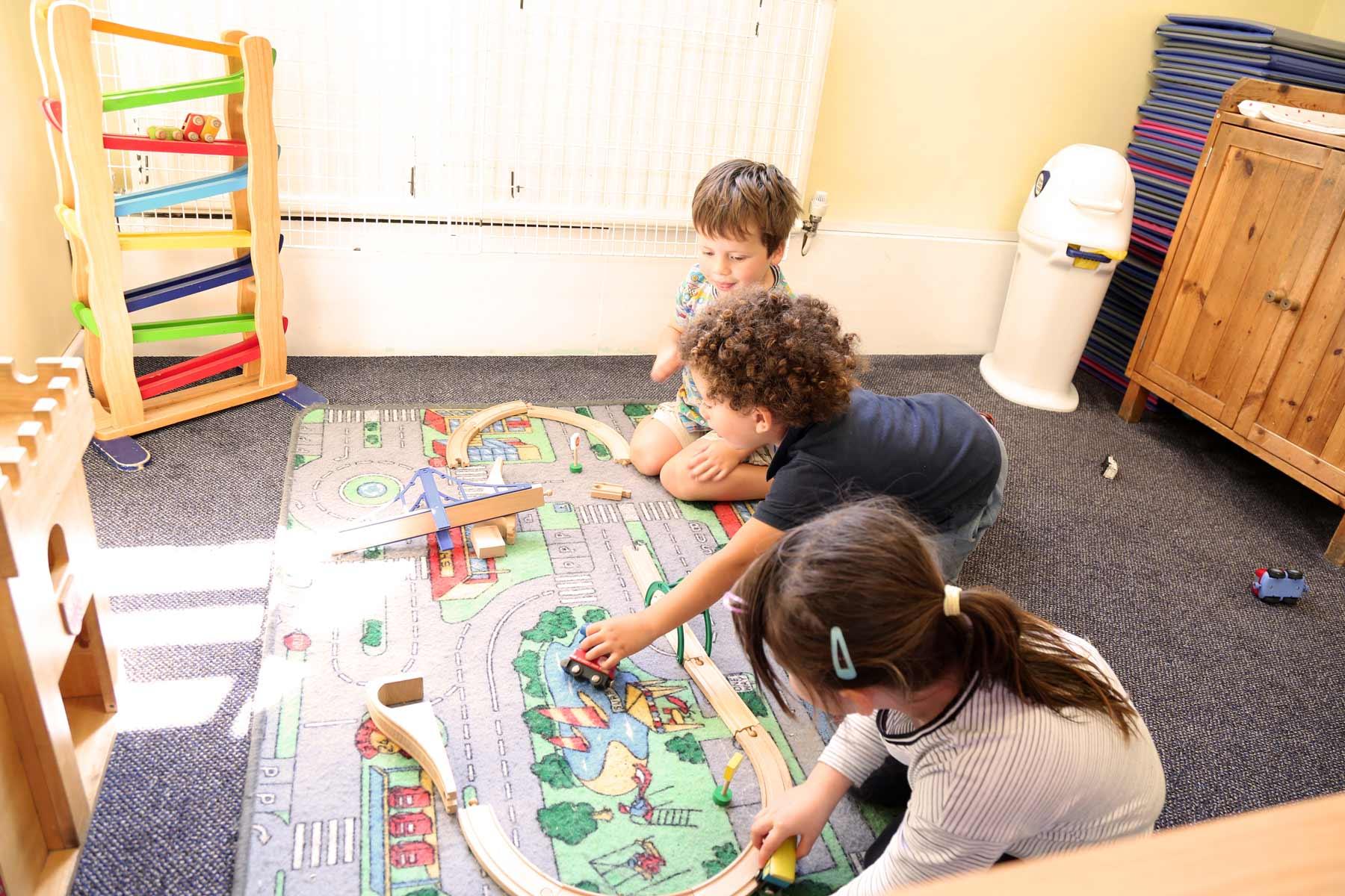 Children playing on a matt