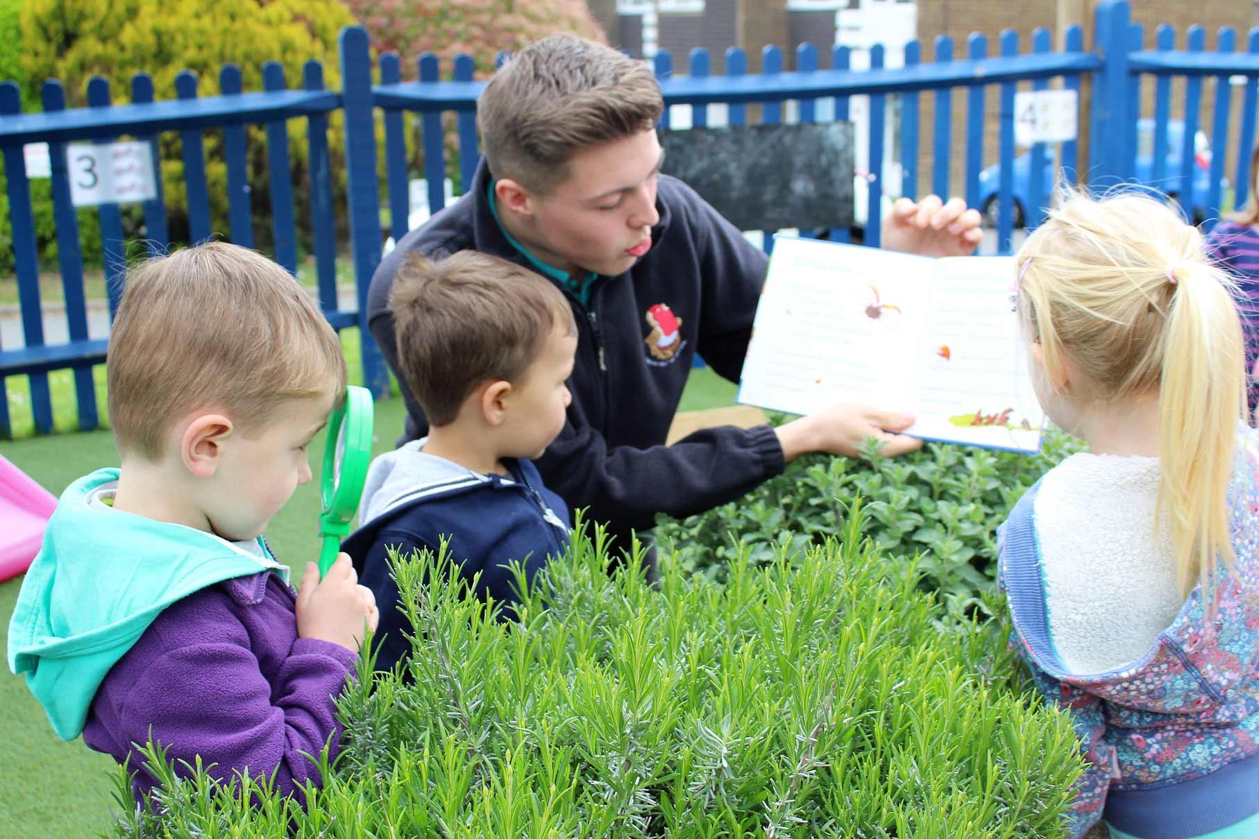 Teacher teaching children about the outdoors