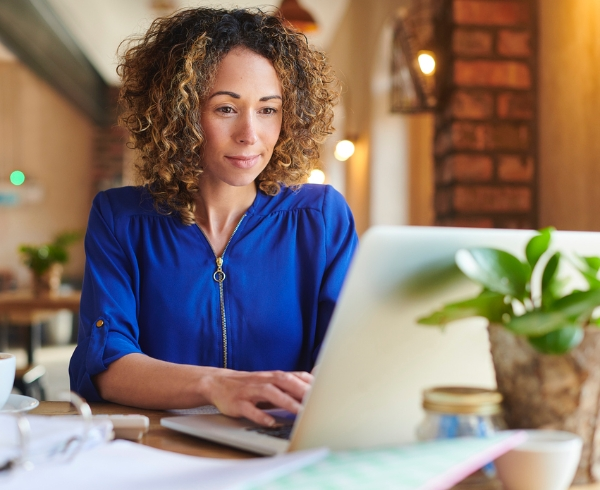 Woman looking at a laptop working