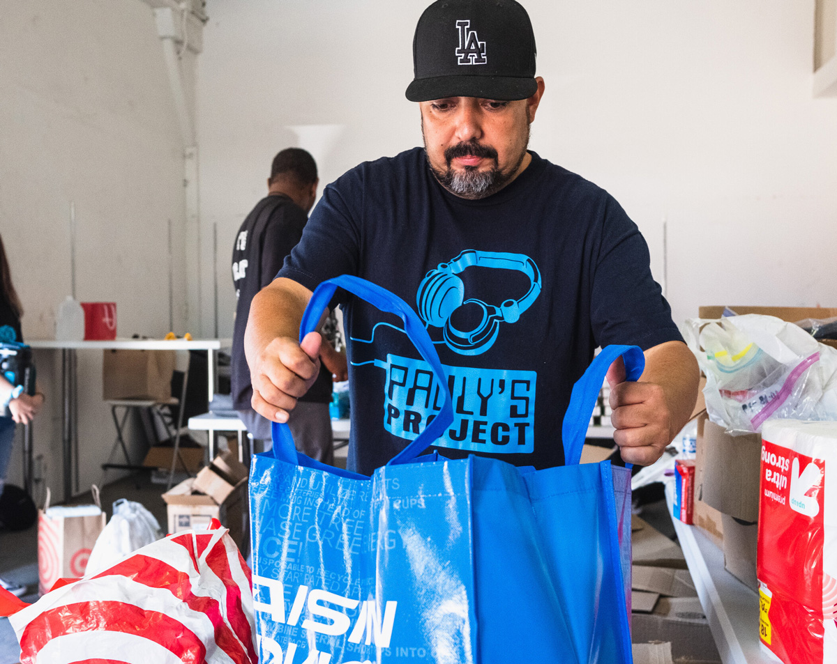 Paul Avila helping out packing a bag