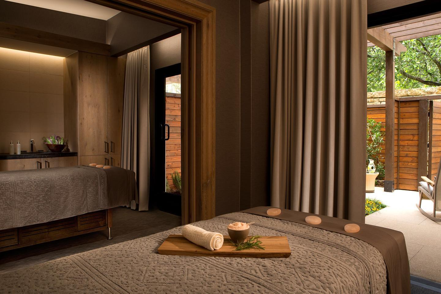 Massage tables with stones in room