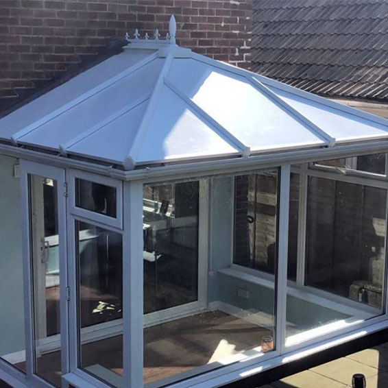a conservatory in saltdean east sussex that has been fitted with insulated, sound deadening solid conservatory roof panels