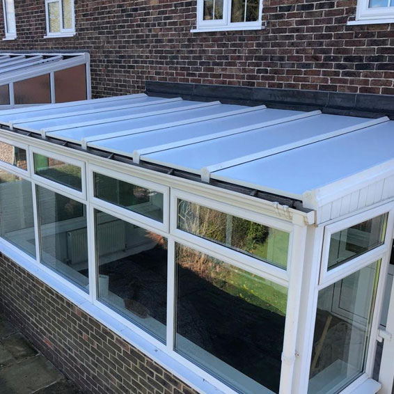 a lean too conservatory with new insulated solid conservatory roof panels in west sussex