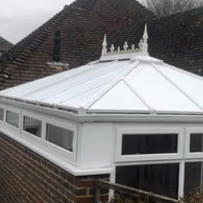 a conservatory with insulated repalcement roof panels in Findon, West Sussex