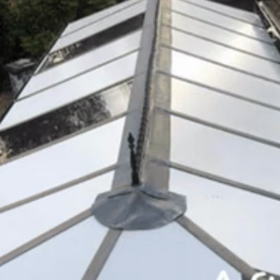 a conservatory roof panel replaced with insulated panels and glazed sections in Farnham, Surrey