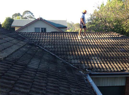 Service man walking on roof