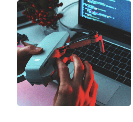 Drone in front of laptop
