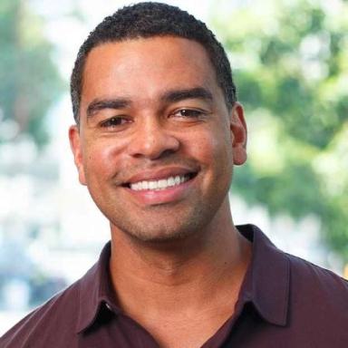 A headshot of Tyson Clark