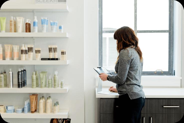 Woman next to bookshelf