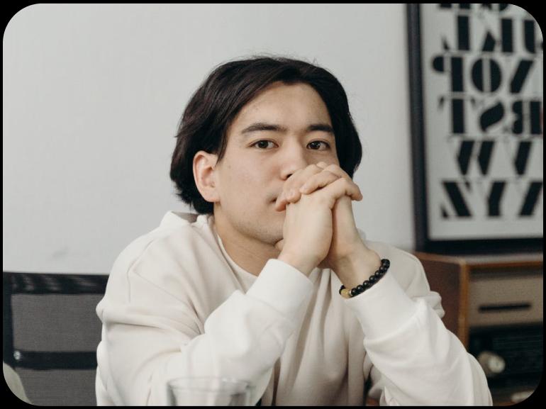A businessman sits at his desk.